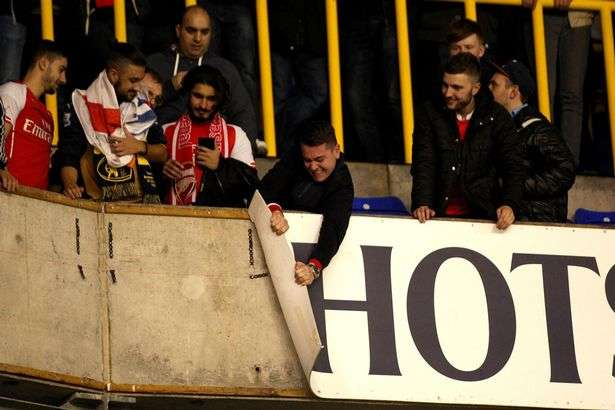 Arsenal 'fans' bring shame on the club as they rub salt into Spurs wounds